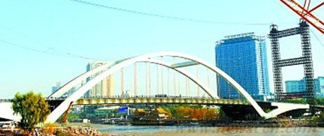 兰州市首座中承式钢箱系杆拱桥 金雁大桥通车